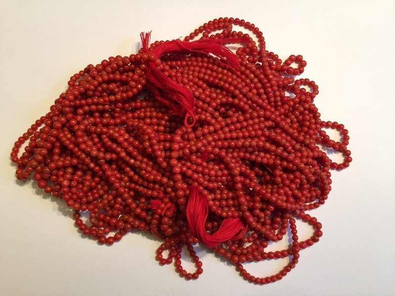 Strings of natural red coral beads