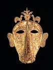 Ritual mask with birds and lizards from the Moluccas