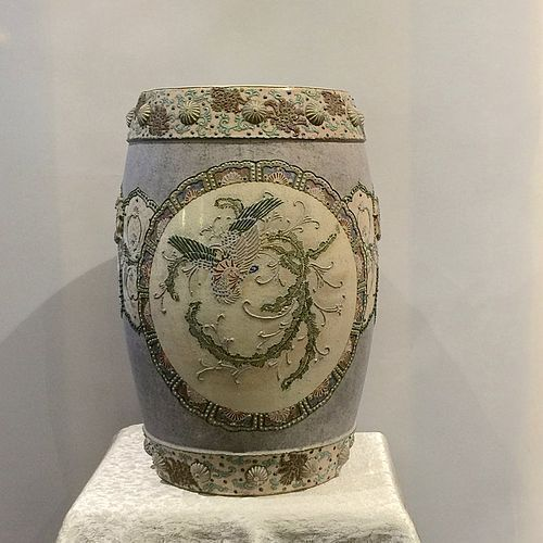 Chinese polychrome ceramic garden seat with colorful medallions