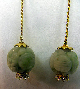 Gold earrings with antique jade beads and diamonds