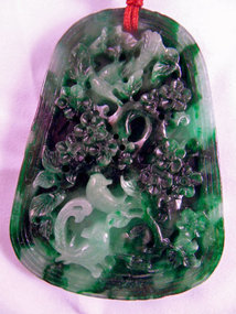 Jadeite pendant with birds and flowers