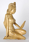 Bali Woodcarving: Statue of a Girl.