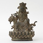 Chinese Ming Bronze Group of Guanyin Seated on a Mythical Beast.