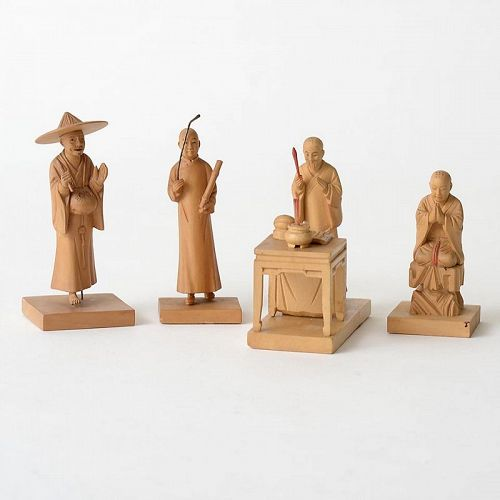 Four Chinese Tushanwan Wood Figurines of Praying Monks, c. 1930.