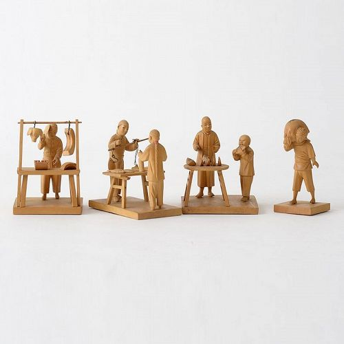 Four Chinese Tushanwan Wood Figurines of Food Marketers, c. 1930.