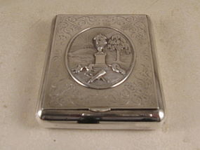 Silver box with miniature inside
