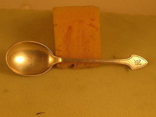 Sugar spoon by Arthur Stone