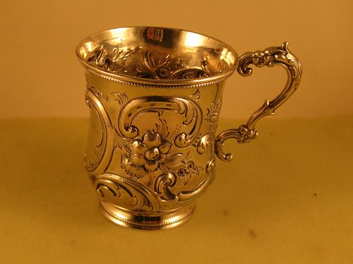 Child's cup, unmarked, circa 1860. Repousse