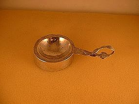 Tea strainer and holder