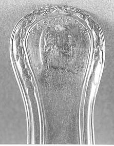 Four teaspoons with bust of Washington and his name