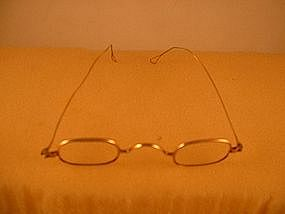 Pair of eyeglasses, marked 16K (gold)