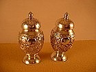 Chinese pair of pepper shakers, marked Gothic K