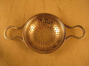 Tea strainer by Int'l Silver; 20th C.