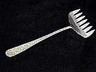 """""""repousse"""" Sterling Bacon Fork By Kirk,  c1925"""
