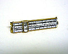 A Slide Rule Tie Clip With Magnifying  cursor