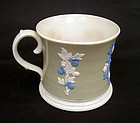 Large tankard with sprigged decoration, early 19th c