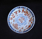 Kangxi Imari saucer, clobbered with the Hundred Treasures