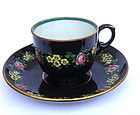 Jackfield black glazed and enamelled cup and saucer, Victorian