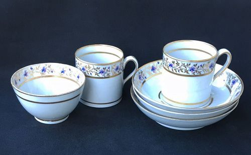 Coffee cans, teabowl and saucers, c 1800, possibly New Hall