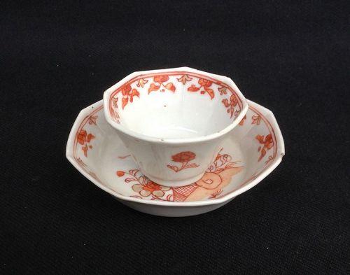 Iron red and gilt octagonal tea bowl and saucer, Kangxi
