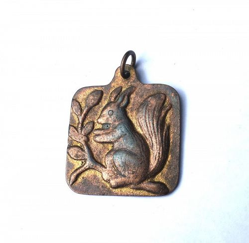 Gilt pewter pendant with a squirrel, by Volmer Bahner, Denmark