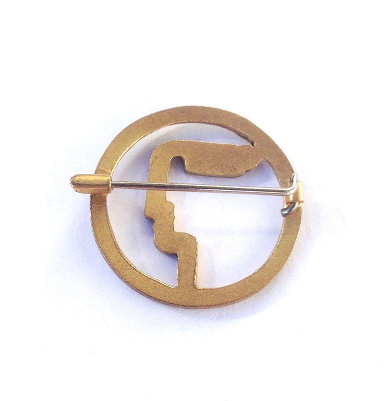 Art Deco circle and profile brooch