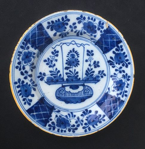 Delft blue and white plate with a flower basket, mid18th century
