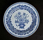 Chinese blue and white plate with a flower basket