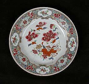 Famille Rose plate with peonies and a tobacco leaf