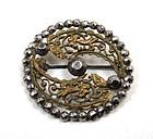 Gilt and Cut Steel Circle Brooch, Cutaway Floral Motif