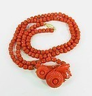 14k gold salmon coral bead necklace carved pendant
