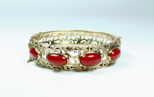 Fine 18k gold natural oxblood coral bangle bracelet