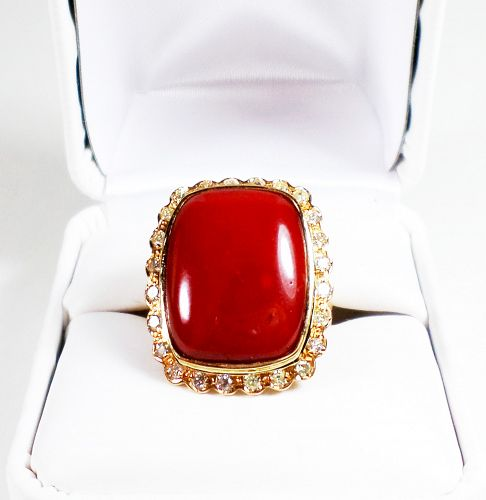 Exceptional, huge 18k gold natural oxblood coral diamond ring