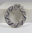 Art Deco platinum, 5.5ctw diamond and sapphire circle brooch, pin.