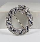 Art Deco platinum, 5.5ctw diamond and sapphire circle brooch, pin.