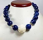 18k gold, lapis lazuli, carved angel skin coral bead necklace