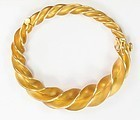Estate, Schlumberger, Tiffany & Co. 18k yellow gold twisted bangle