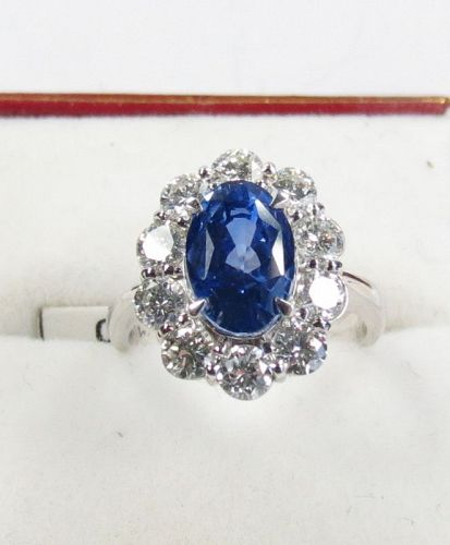 Platinum, 4.2ctw natural no heat sapphire, 2.5ctw diamond ring. Cert.