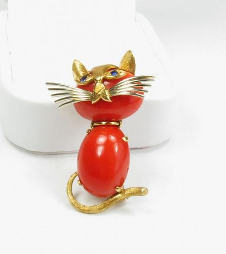 Cartier, 18k gold, red Mediterranean coral cat pin with sapphire eyes