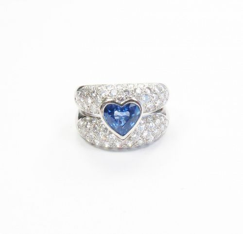 Signed, 18k white gold, 1.5ctw sapphire, 1.7ctw diamond band ring