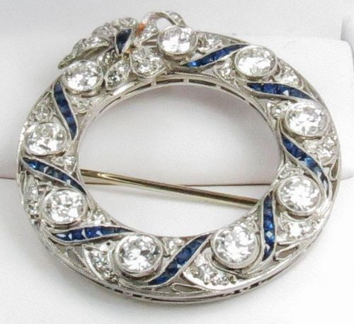 Art Deco Platinum, 4.5 carats of diamonds, sapphire circle pin brooch