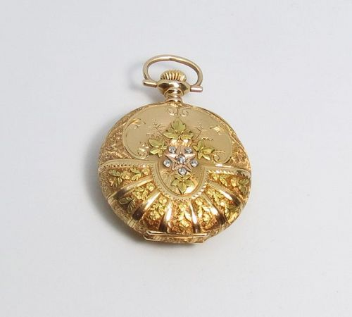 Antique, 14k yellow rose gold Waltham hunter pocket watch