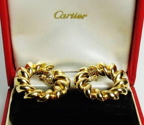 Cartier, France, 18k gold twisted hoop earrings