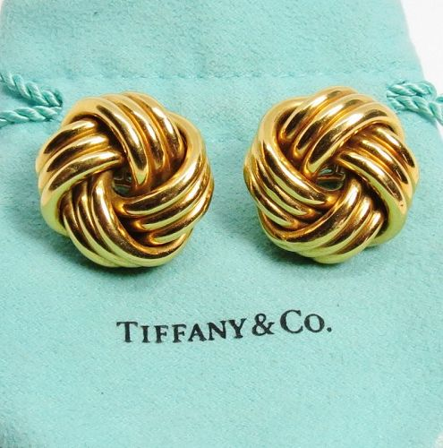 Large, 18K gold love knot earrings by Tiffany & Co.