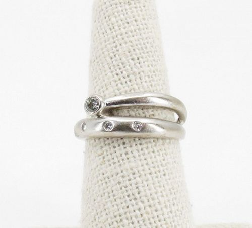 14k white gold, diamond band ring. Modern desiagn.
