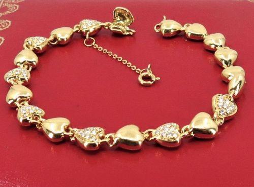 Cartier, diamond, 18k gold heart link bracelet