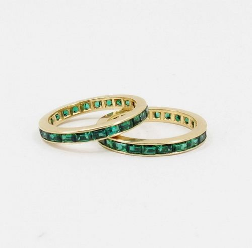 Pair of emerald eternity bands rings in 14k gold
