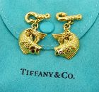 Tiffany & Co fish cufflinks in 18k yellow gold. Ruby eyes.