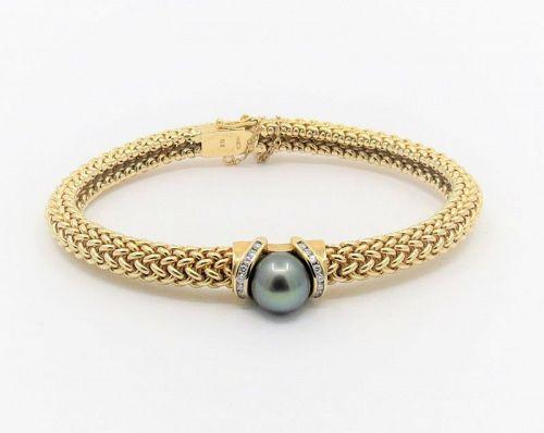 Tahitian pearl, diamond bangle bracelet in 14k gold. Designer signed