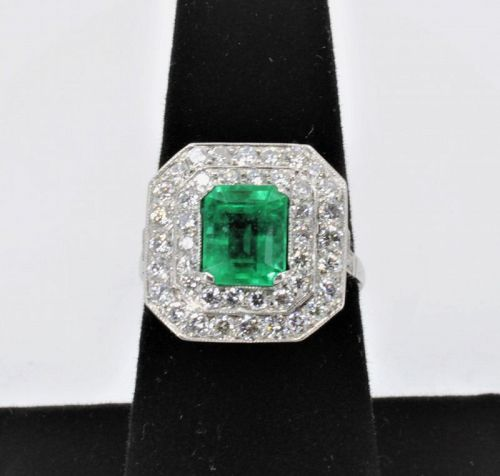 Emerald diamond engagement ring in Platinum